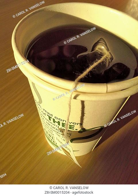 Tea to go in paper cup, with tea bag still in cup
