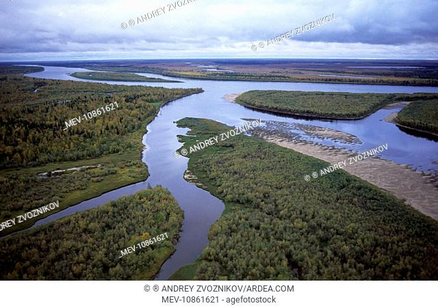 River Taz with sand-shelves, old river beds & islands. Taiga-forest and marshes. Aerial, North Tumen region, Siberia, Russia