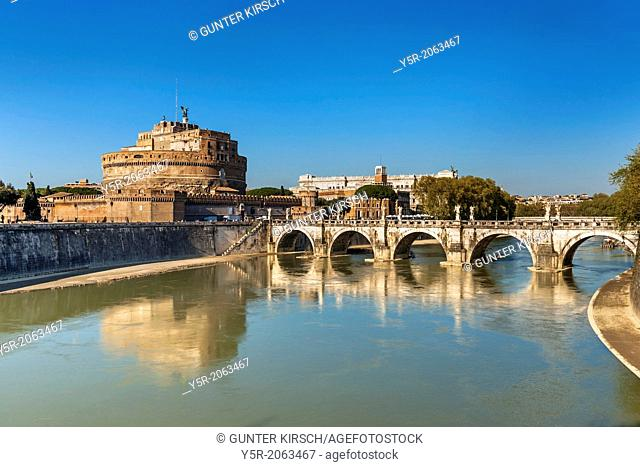 View over the river Tiber to the bridge Ponte Sant'Angelo and the Castle of the Holy Angel, Castel Sant'Angelo. The Castel Sant'Angelo was originally built as a...