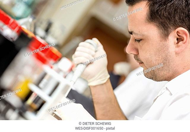 Lab technician analysing blood sample