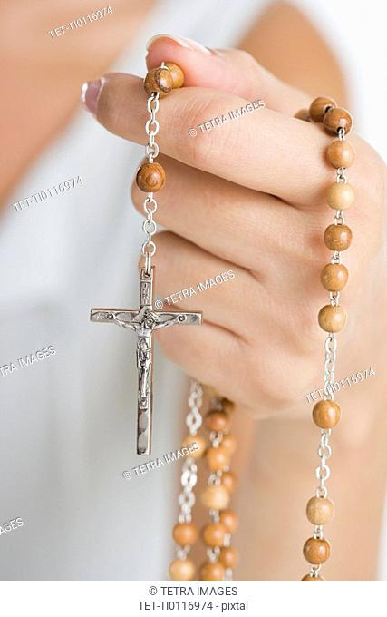 Female hand with rosary
