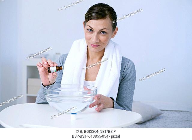 Woman taking inhalation