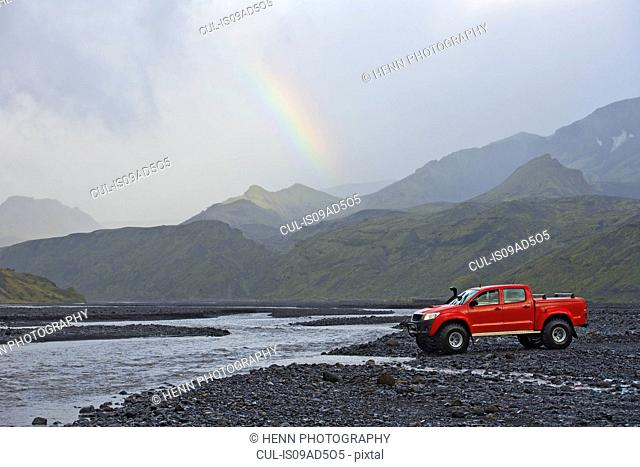 Customised SUV waiting to cross the glacial river Krossa, Thorsmork, Iceland