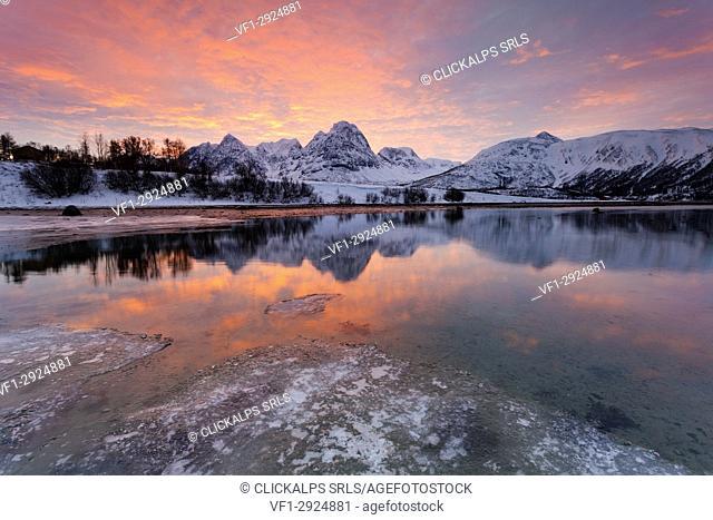 Delicate colors sunrise to Balsfjorden. Storsteinnes, Balsfjorden, Lyngen Alps, Troms, Norway, Lapland, Europe