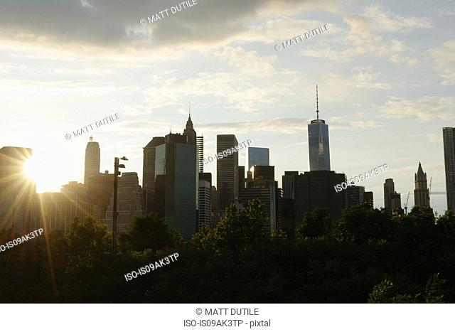 Silhouetted view of lower Manhattan at dawn, New York, USA
