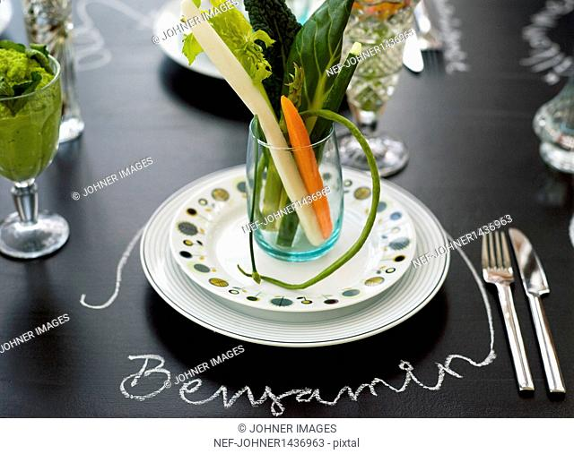 Table setting with fresh vegetables