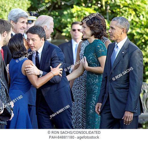Prime Minister Matteo Renzi of Italy hugs United States National Security Advisor Susan Rice as US Vice President Joe Biden greets Mrs