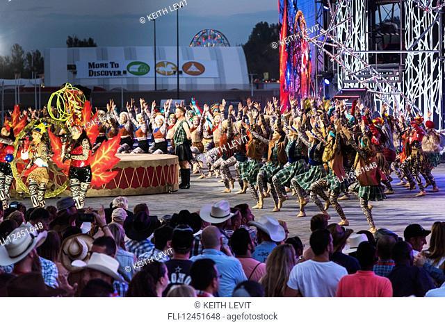 Dancers entertaining a crowd at the Calgary Stampede; Calgary, Alberta, Canada