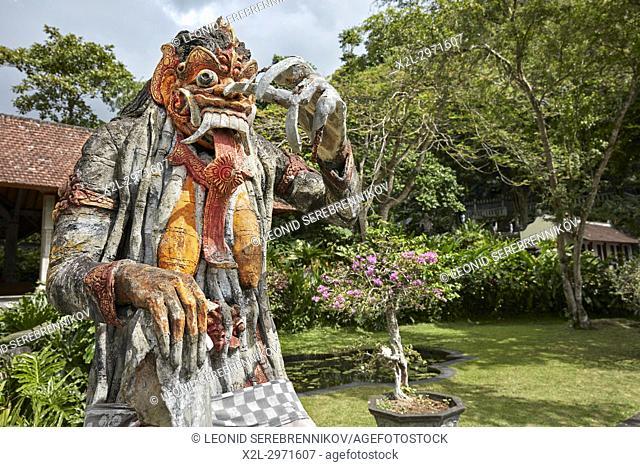 Statue of Rangda, the demon queen, in the Tirta Gangga water palace. Karangasem regency, Bali, Indonesia