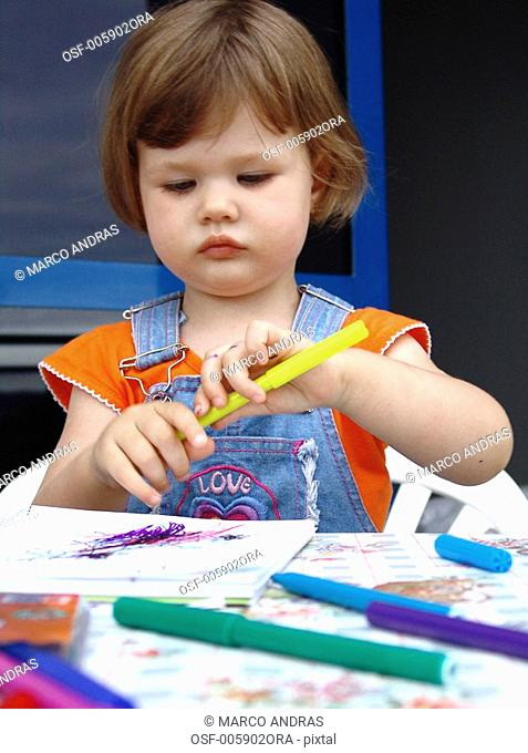 one girl painting a paper draw