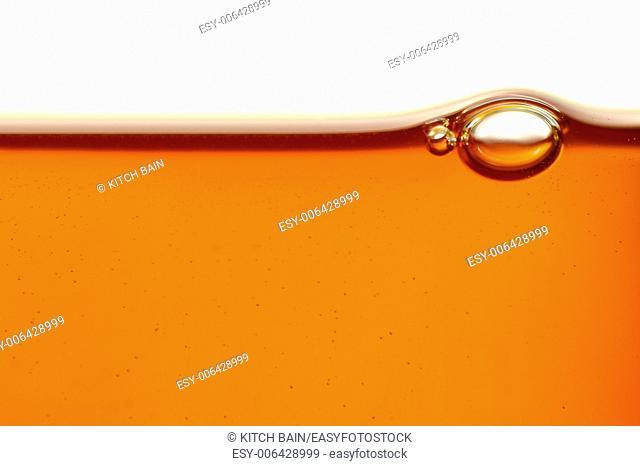 A close up shot of a honey bubble