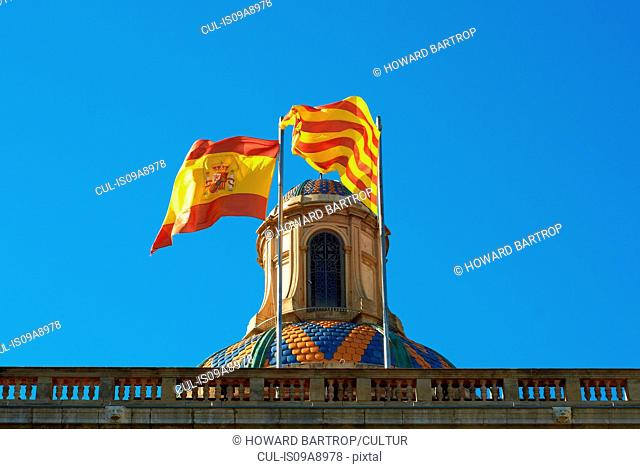 Spanish flags in building, Barcelona, Spain