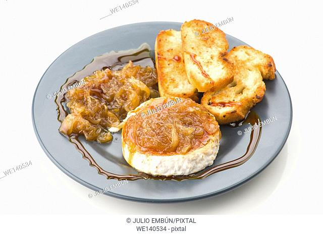 goat cheese with caramelized onions, garnished with balsamic vinegar