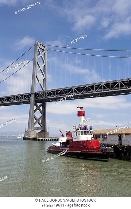 "San Francisco, California: Fireboat """"Guardian"""" at the The Fireboat House along the Embarcadero with the San Franciscoâ. ""Oakland Bay Bridge"