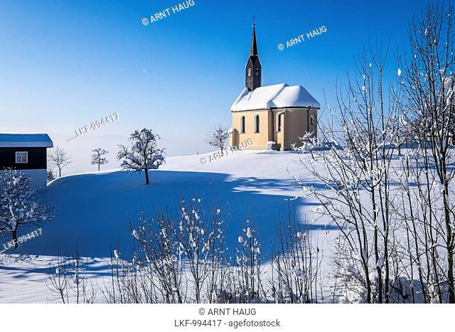 chapel in a winter wonderland near Dornbirn, Vorarlberg, Austria