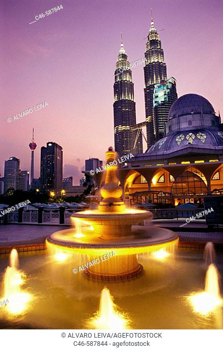 Petronas twin towers (the tallest building in the world), Asy-Syakirin Mosque in the KLCC Park in foreground. Kuala Lumpur. Malaysia