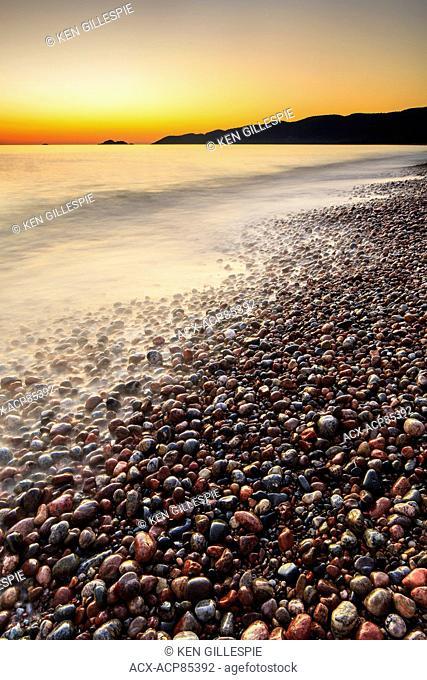 A Pebble beach at sunset on Lake Superior at Agawa Bay, Lake Superior Provincial Park, Ontario, Canada