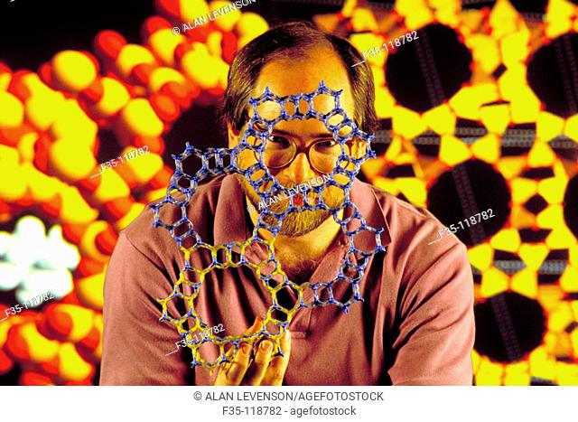 Chemical engineer holding molecular model