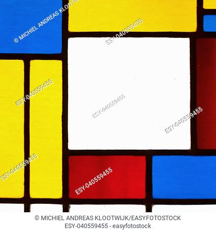 Image of a multicolored stained glass window with irregular block pattern