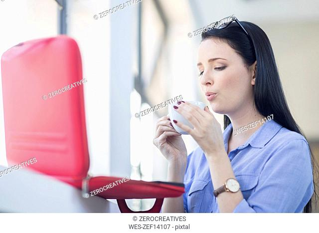 Employee cooling coffee down before drinking it