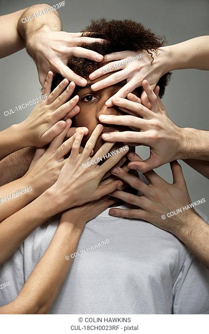 Black male hidden by hands