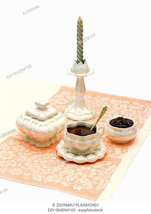 cup of tea and sugar jam on a napkin