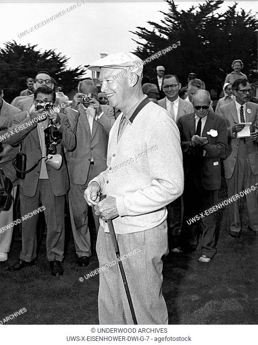 Pebble Beach, California: 1956. President Eisenhower with a golf club in his hand meets the press at Pebble Beach, California