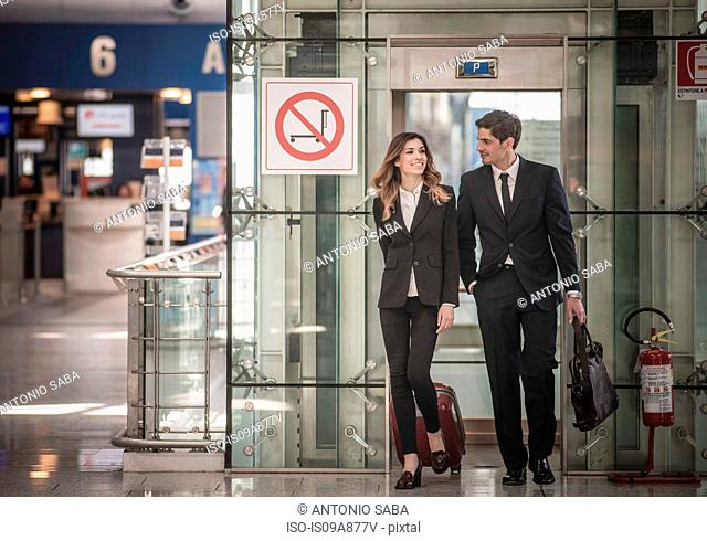Businesspeople arriving in airport