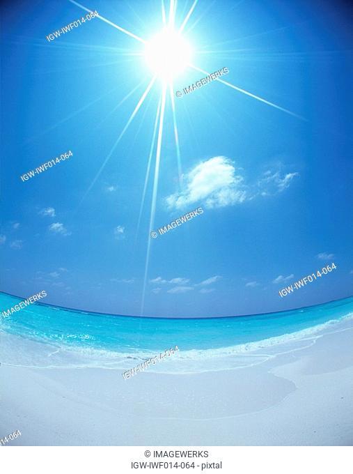 View of seashore under sun