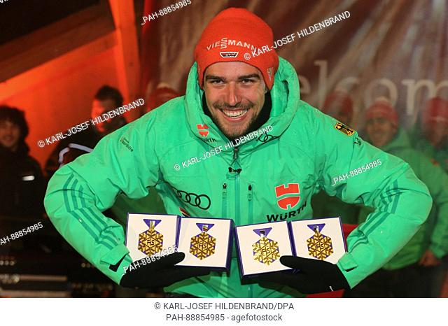 Winter sports athlete Johannes Rydzek shows off his gold medals the local ski club in Oberstdorf, Germany, 08 March 2017