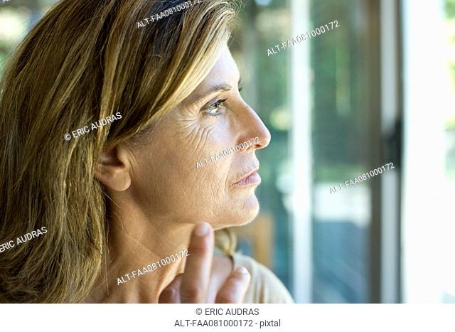 Mature woman looking away in thought