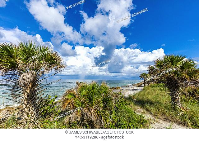 Boardwalk with big white clouds over the Gulf of Mexico at Caspersen Beach in Vencie Florida