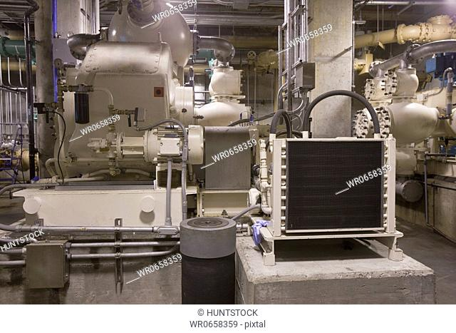 Heavy machinery with radiator unit and pumps in a sewage treatment plant