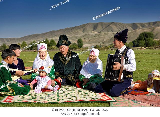 Traditional Kazakh family singing at a picnic in pastureland of Saty Kazakhstan