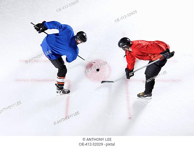 Hockey opponents in opening face off