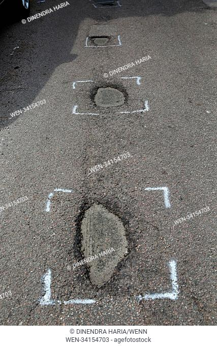 A number of potholes are seen in a single road in north London. Featuring: Atmosphere, View Where: London, United Kingdom When: 03 May 2018 Credit: Dinendra...