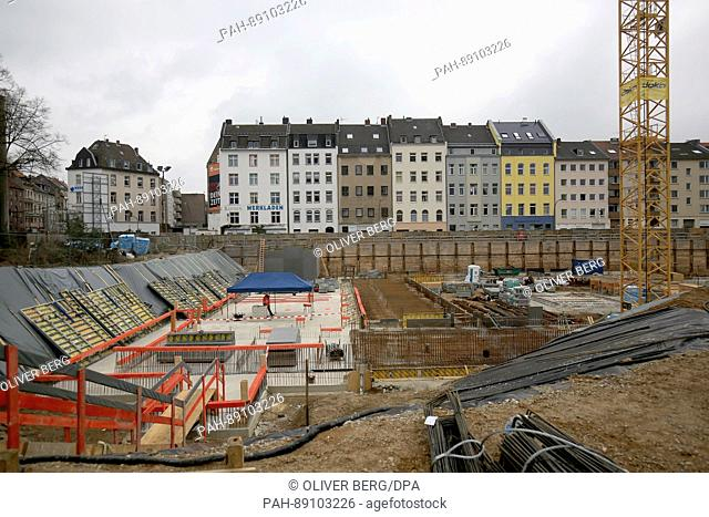 Cranes loom over the construction site where the new Historical Archive is to be built in Cologne, Germany, 17 March 2017