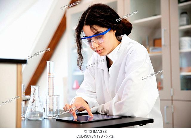 Student using digital tablet in laboratory