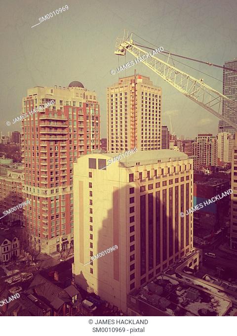 Condos, office buildings and a crane near Bloor St. in Toronto, Ontario, Canada