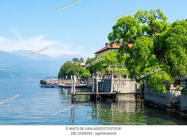 Waterfront on lake Orta with port and building with trees in a sunny day in Piedmont, Italy