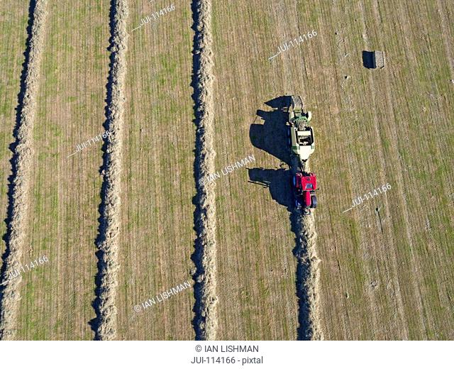 Aerial View Of Tractor Baling Hay In Field