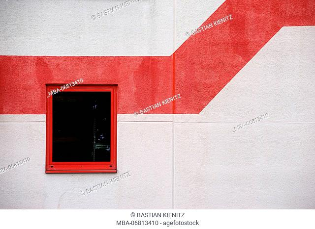 Window of a modern office building with red zigzag shaped painting for decoration