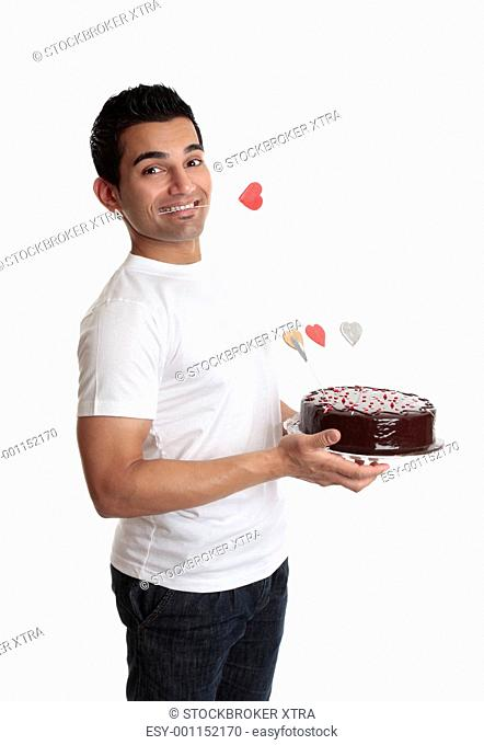 Cheeky man with a love heart cake