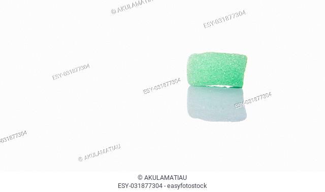 Light green colored sugar jelly candy over white background