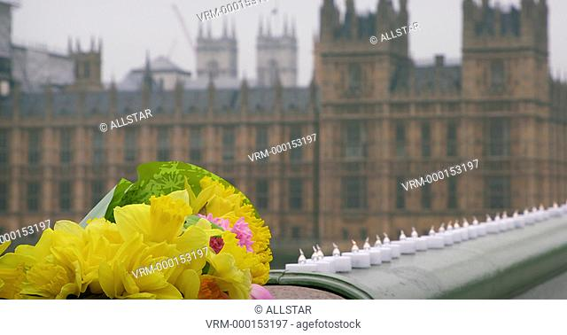 FLOWERS LEFT IN MEMORY OF VICTIMS OF TERROR ATTACK; WESTMINSTER BRIDGE, LONDON; 24/03/2017