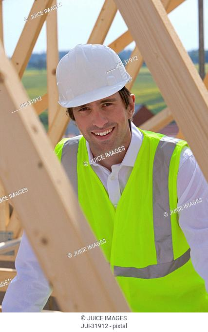 Portrait of smiling construction worker at construction site