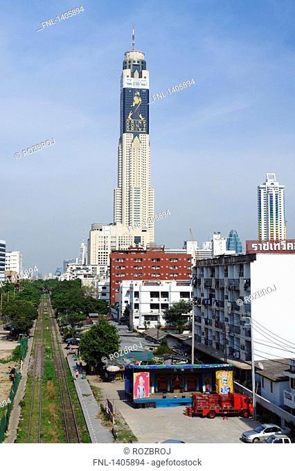 High angle view of railroad tracks running along buildings in city, Bayoke Tower, Bangkok, Thailand