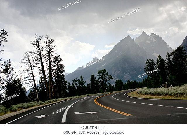 Road Leading to Teton Mountain Range, Grand Teton National Park, Wyoming, USA