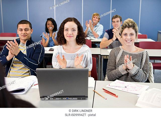 University students applauding in class