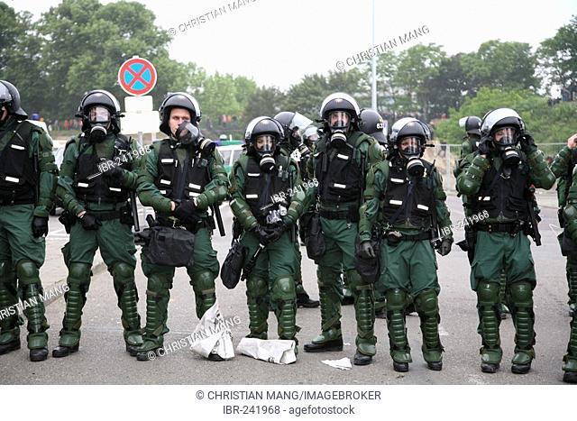 Policemen wearing gasmasks